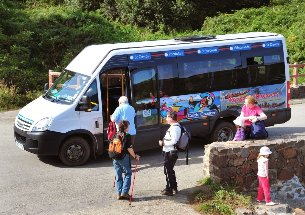 Minibus picking up passengers