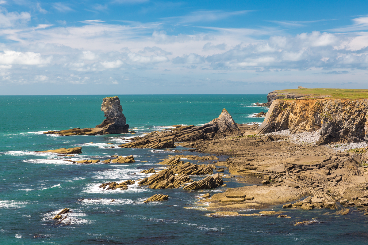 Limestone sea stack known as Pen y Holt stack on the Castlemartin Firing Range,