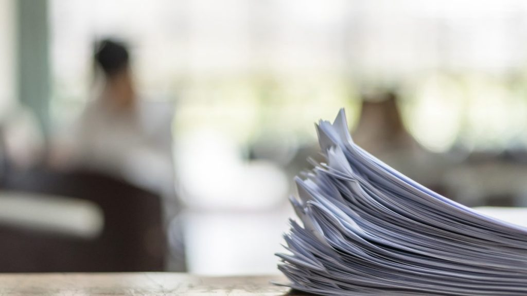 Documents on table in office