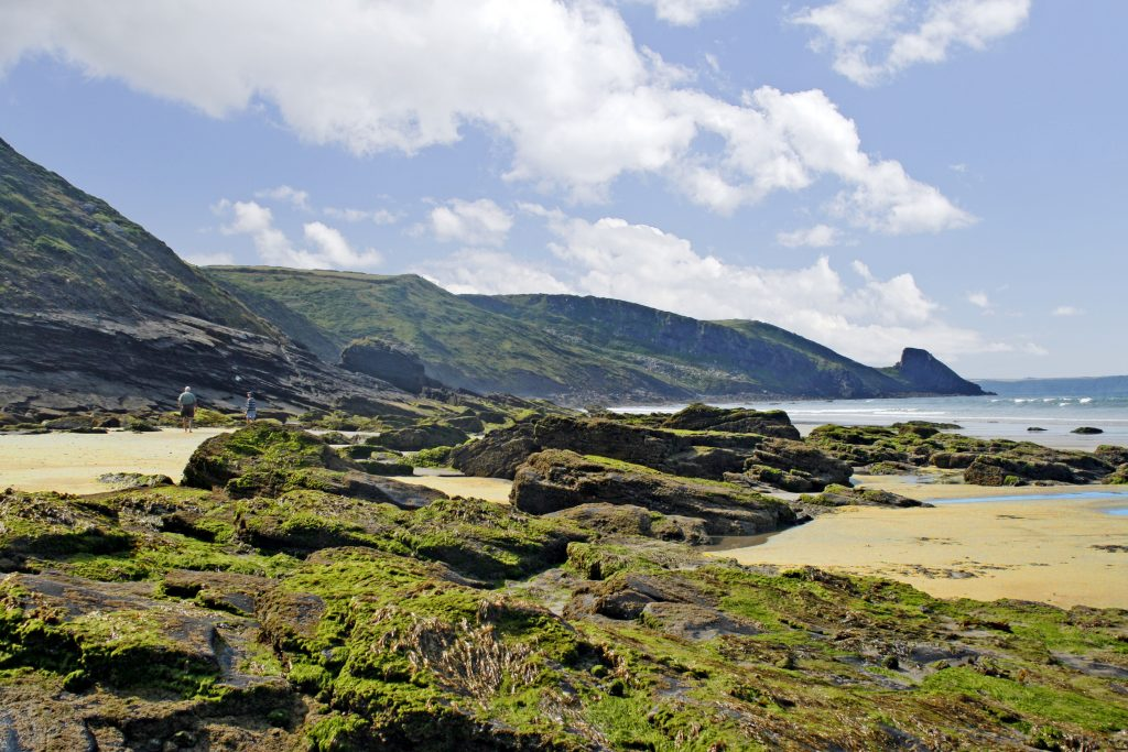 Rockpools at Newgale beach with Rickets Head in the background