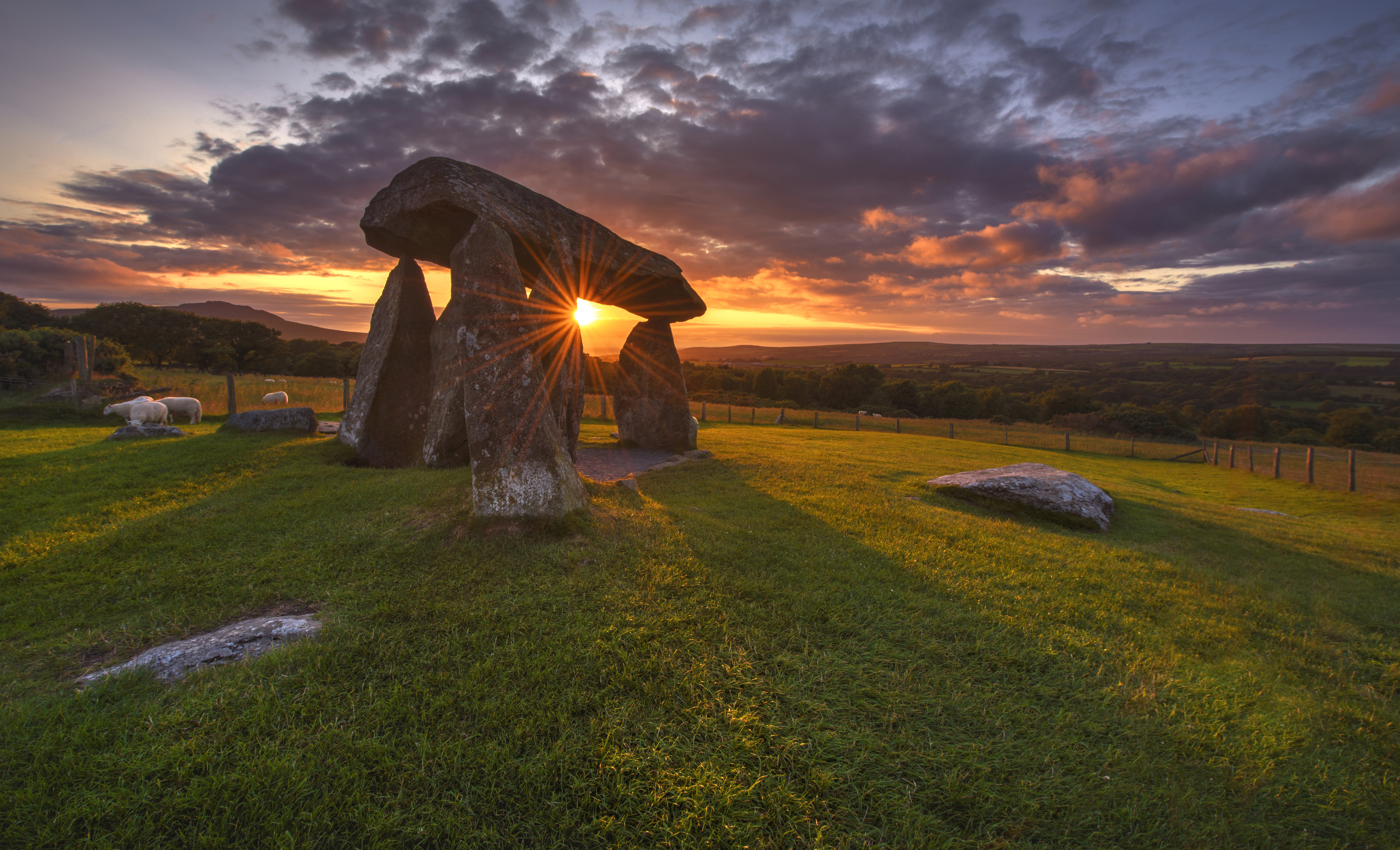 Colorful sunset over Pentre Ifan Burial chamber, Wales, England