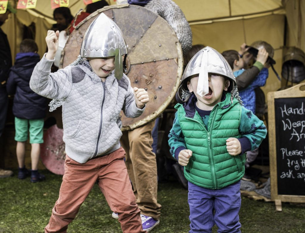 Children dressed as knights at a Carew Castle event.