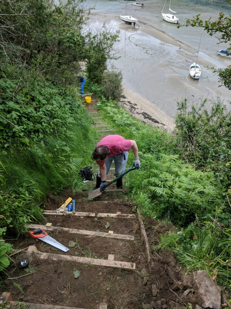 Pathways volunteers installing steps at Solva Harbour