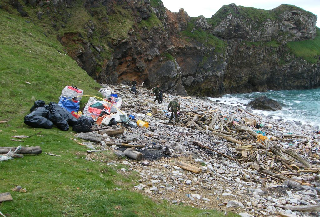 Beach clean at Bullslaughter Bay on the Castlemartin Range, Pembrokeshire Coast National Park, Wales, UK