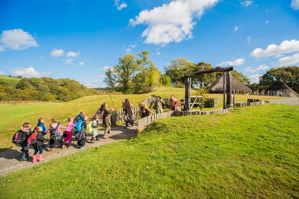 School group enter Castell Henllys Iron Age Village