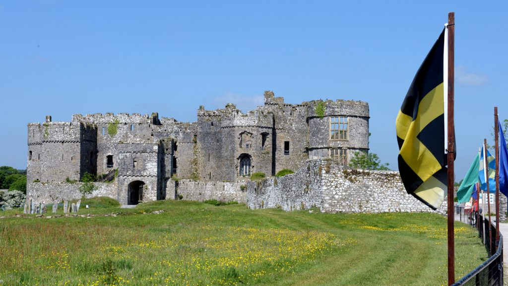 Entrance to Carew Castle with flags waving