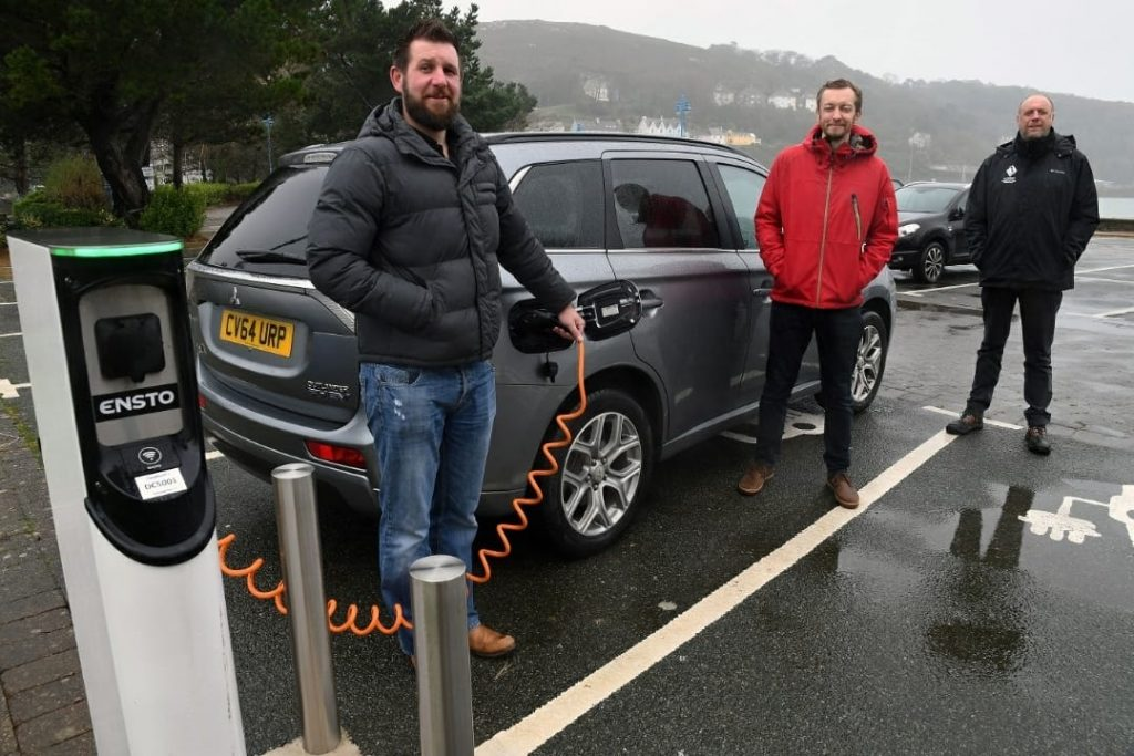 Pictured with the Council's Sustainable Development and Energy Manager, Steve Keating (centre) at the electric vehicle charge-point at the Parrog in Goodwick are: Andrew Mackay (left), Construction Project Manager at Silverstone and Andrew Muskett, Building Projects Manager at the Pembrokeshire Coast National Park Authority.